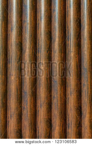 New log texture as background with a copy of the space. Brown vertical logs texture.