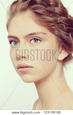 Vintage style portrait of young beautiful healthy girl with clean make-up and braids