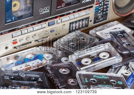 Zhytomyr, Ukraine, 24 March 2016. Cassette tape recorder Sharp model QT-90ZG with cassettes. The tape recorder was made in Japan for export. Cassettes are scattered on the table near the tape recorder