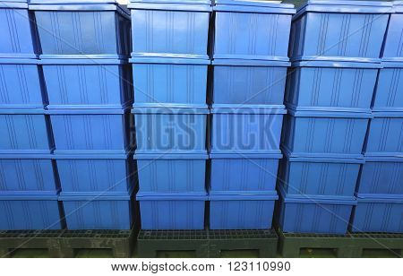 blue Plastic box products in Industrial factory roomContainer of finished goods germ-free.