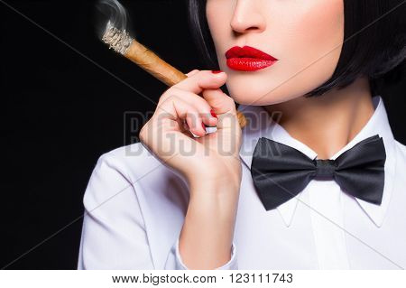 Gangster woman with cigar smoking white shirt and tuxedo