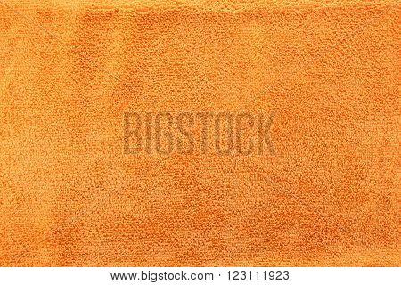 Orange color Texture of microfiber Cloth for the design background.