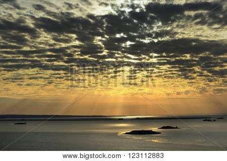 Cirrus Clouds At Sunset Over The River