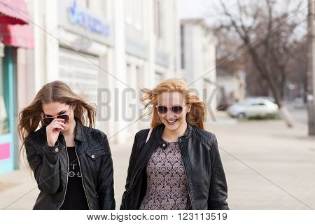 Two Female Friends Enjoying A Walk In Sunny Wheather