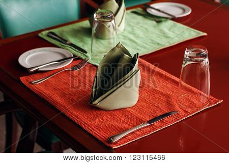 Dining Table Setting with Textile Napkin and Crockery