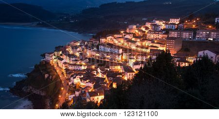 View of the city of Lastres at nightfall Asturias Spain. Photographs updated in March 2016