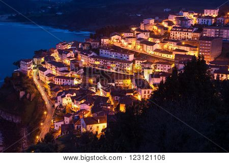 View of the city of Lastres at nightfall .II Asturias Spain. Photographs updated in March 2016