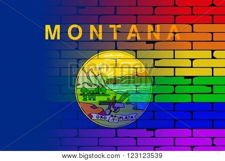 A well worn wall painted with a LGBT rainbow with the Montana state flag