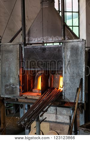 Antique Glass Furnace and Iron Blow Pipes in Murano Isle near Venice Italy