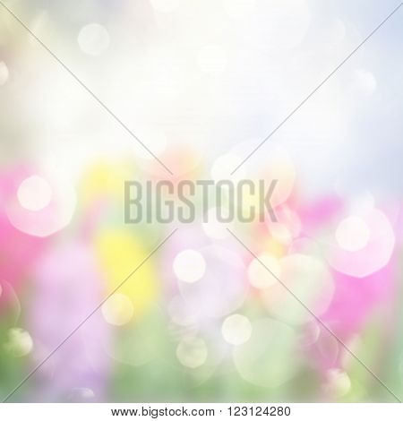 Gleaming multicolored pastel festive background with bokeh bubbles