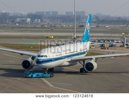 Amsterdam Schiphol Airport Noord Holland/the Netherlands - March 10 2016: China Southern Airlines aircraft being towed