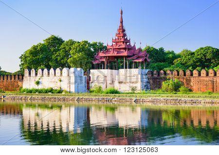Mandalay, Myanmar royal palace tower and moat.