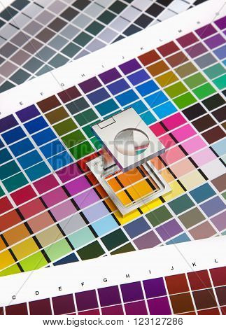 press color management chart swatch magnifying glass