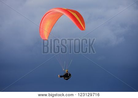 Paraglider flying his wing in stormy weather ** Note: Soft Focus at 100%, best at smaller sizes