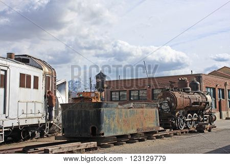 Steam engine and trucks in a railway siding