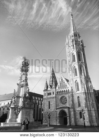 BUDAPEST, HUNGARY, JULY 10, 2015: Matthias Church exterior, a Roman Catholic church located in Budapest, Hungary, in front of the Fisherman's Bastion at the heart of Buda's Castle District.