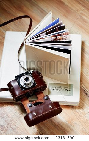 photobook with a cover of light leatherette with the old camera ** Note: Visible grain at 100%, best at smaller sizes