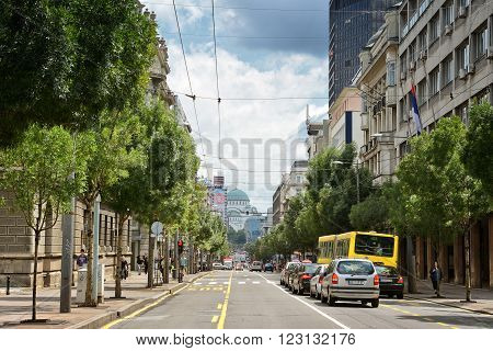 BELGRADE, SERBIA, JULY 3, 2014: Wide angle shot of a Belgrade street with low traffic, Church of Saint Sava can be seen on the background.
