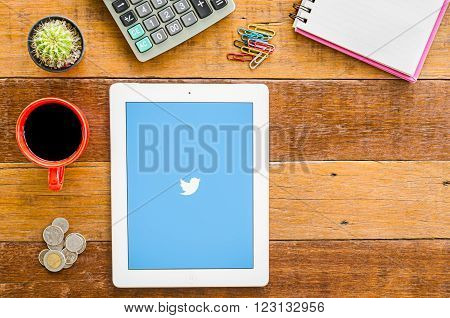"CHIANGMAI, THAILAND -JANUARY 10, 2016: IPad 4 open Twitter application.Twitter is an online social networking and microblogging service that enables users to send and read ""tweets""."