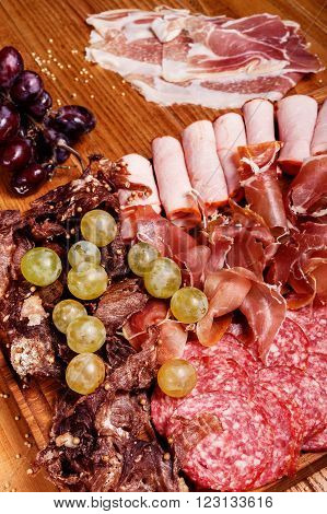 Cold Meat Plate On Wooden Cutting Board