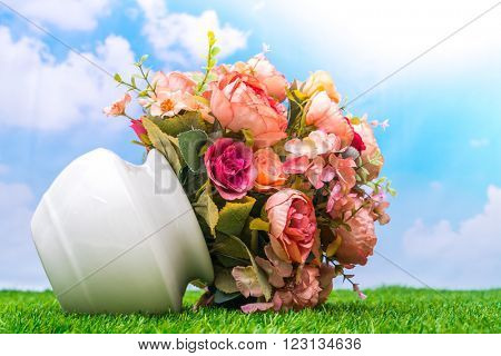 Beautiful of artificial flowers on grass