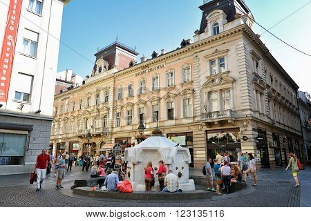 BELGRADE, SERBIA, JULY 2, 2014: People drinking water and having a break at Knez Mihailova Street, the main shopping mile of Belgrade.
