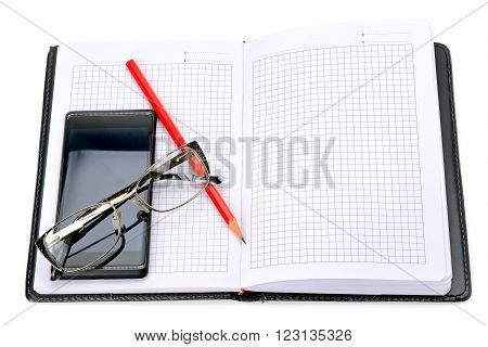 mobile phone glasses and notebook isolated on white background