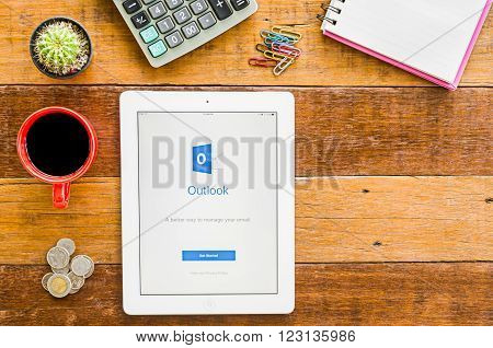 CHIANGMAI, THAILAND -JANUARY 10, 2016: IPad 4 open outlook application. Microsoft Outlook is used for emails and also personal management of information.