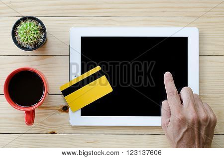 Man using credit card and digital tablet computer for buying on line. Online shopping