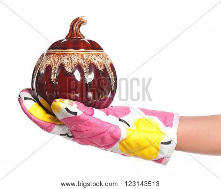 Female hand with cooking ceramic pot isolated over white background