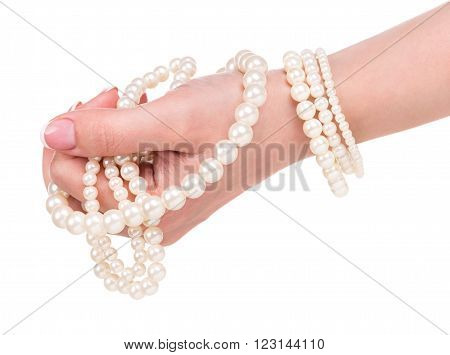 Young female hand with pearl jewellery isolated over white background