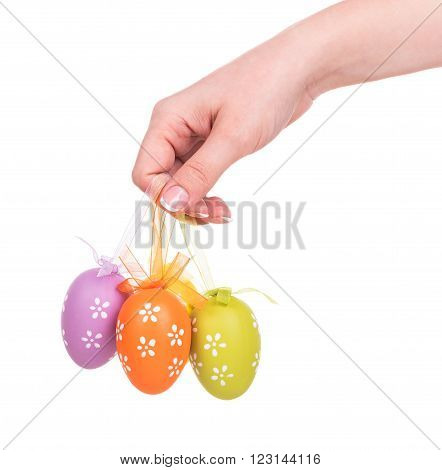 Young female hand with decorative Easter eggs isolated over white background