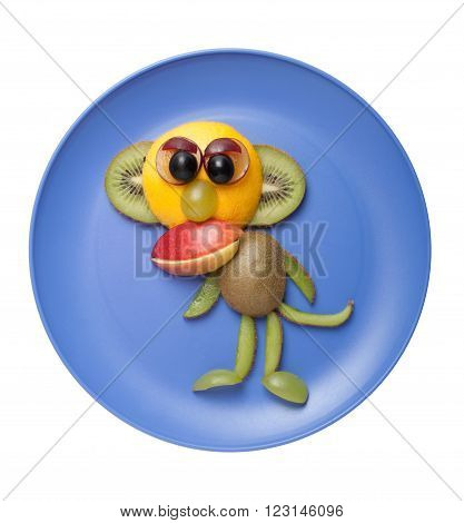 Amusing ape made of fresh fruits on blue plate