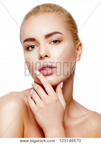 Adult woman with beautiful face - isolated on white. Skin care concept. Portrait of beautiful young blonde girl with clean face. Touching her face.