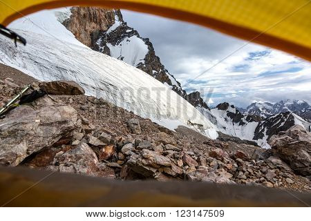 Landscape from Camping Tent Vanishing Point Steep Glacier Tongue  Ice and Rock Cliff Terrain Alpine Gear