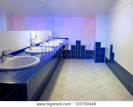 Public toilet with washbasin.A number of wash basins