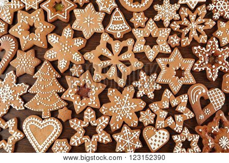 Christmas homemade gingerbread cookies on wooden table.