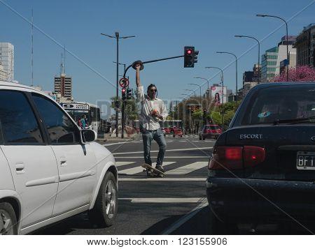 Buenos Aires Argentina - 18th October 2015: A juggling street performer at traffic lights.