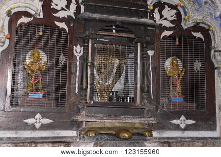 The Hindu altar in the temple - on a turtle sits a snake - a royal cobra