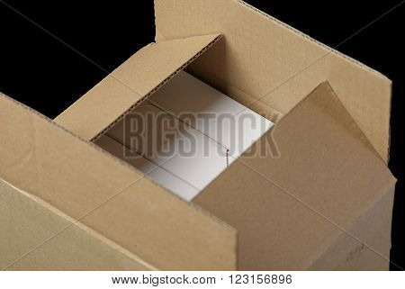 semi-open package with white boxes and black background