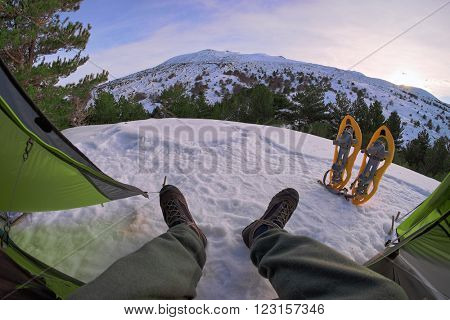 view of snowy volcano etna from inside a tent, Sicily