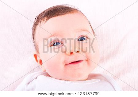 Image of a funny beautiful baby girl.
