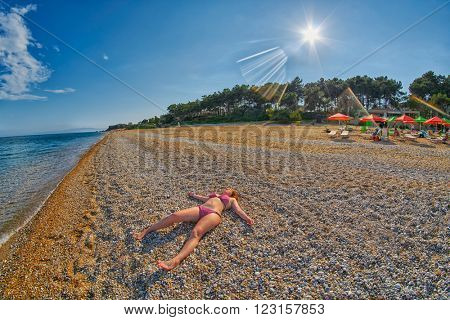Young Girl Relaxing on a Skala Beach in Kefalonia, Greece