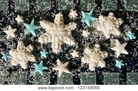 colorful festive Christmas snowflakes and stars from sugar mastic