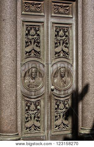 Ornate religious details on tomb in  La Recoleta Cemetery