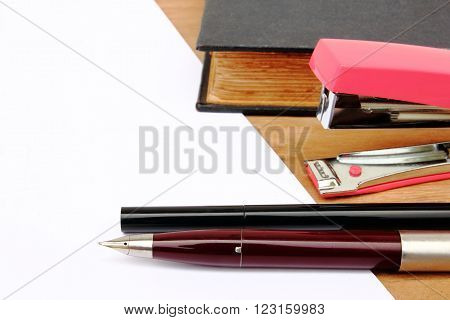 Close-up pen and stapler on the table ** Note: Visible grain at 100%, best at smaller sizes