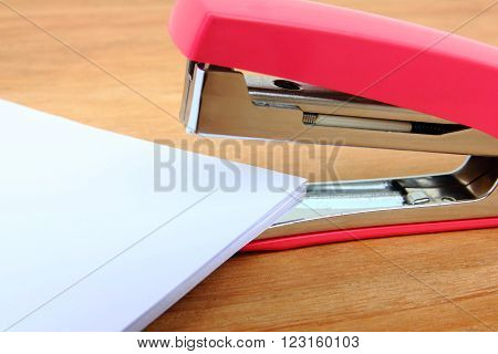 Close-up stapler and papers on the table
