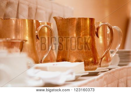 Set of copper jug on the table