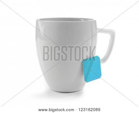 Cup of tea isolated on white background. Teabag with blue label