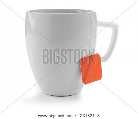 Cup of tea isolated on white background. Teabag with red dotted label